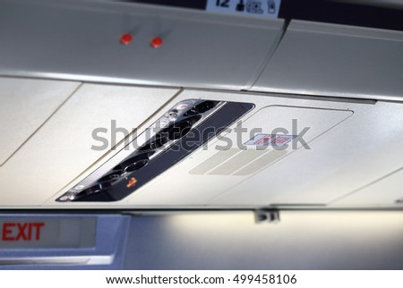 Close-up of airplane overhead panel with no smoking icon