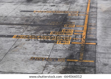 Close-up of Airplane ramp markings sign strips at the airport.