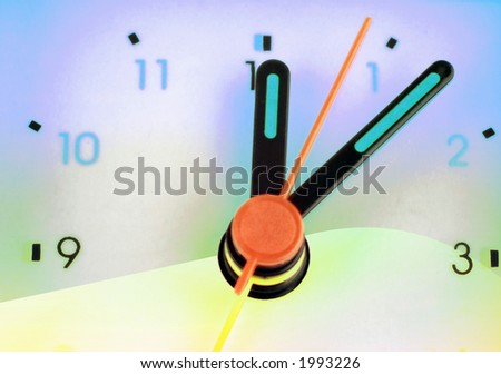 Close up of alarm clock face with added color effects - stock photo