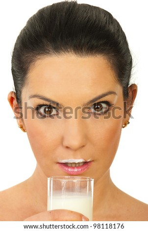 Close up of amazed woman with milk mustache after drinking milk isolated on white background - stock photo