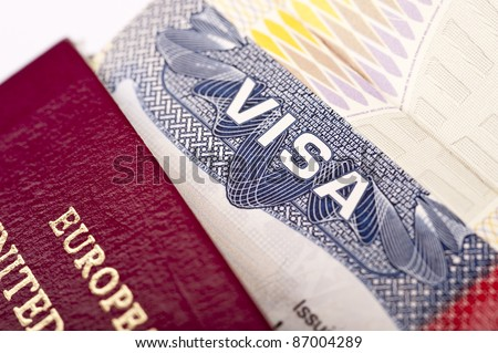 Close-up of american visa with european passport - stock photo
