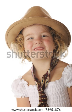 Close-up of an adorable preschooler in a sundress and her grandpa's wide tie and felt hat. - stock photo