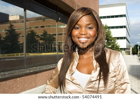 Close-up of an African American woman smiling in suburbs - stock photo