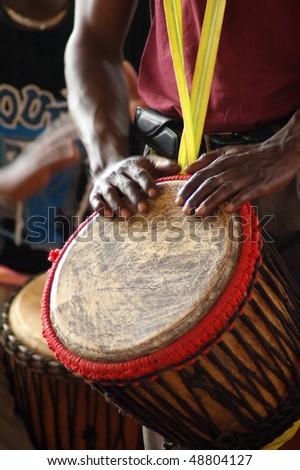 Close up of an African djembe drummer - stock photo