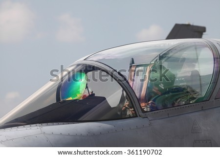 Close-up of an air force pilot in the cockpit of an airplane. He - stock photo