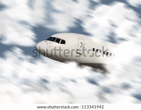Close up of an airplane's nose flying through the clouds - stock photo