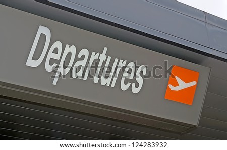 close up of an airport departures sign - stock photo
