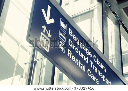 Close up of an airport exit sign - stock photo