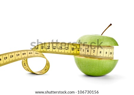 close up of  an apple measuring tape on white background with clipping path - stock photo
