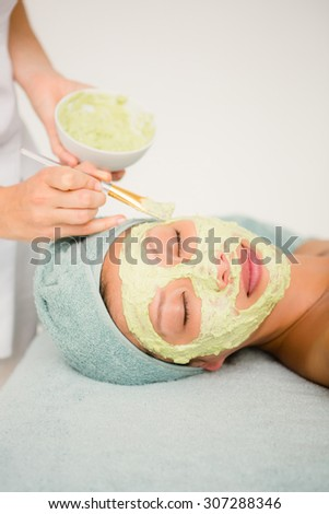 Close up of an attractivce woman receiving treatment at spa center