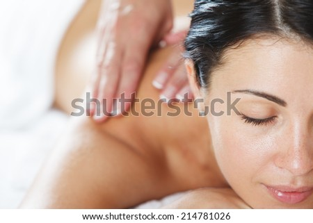 Close-up of an attractive women having a back massage - stock photo