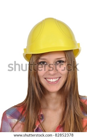 Close-up of an attractive young woman with a yellow helmet - stock photo