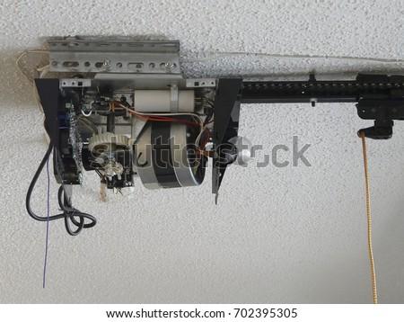 Closeup Automatic Garage Door Opener Motor Stock Photo 702395305