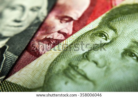 Close-up of an Chinese yuan, a Russian Ruble and an American dollar banknote - stock photo