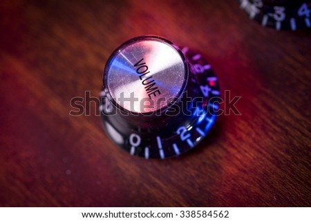 Close-up of an electric guitar's volume knob - stock photo
