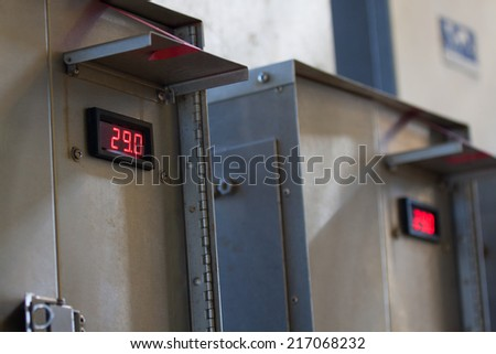 Close up of an Electric meter,Electric utility meters for an apartment complex or offshore oil and gas plant - stock photo