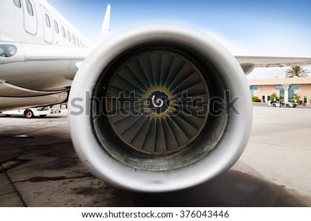 Close up of an engine of passenger jet plane