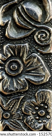 close up of an engraving in metal - stock photo