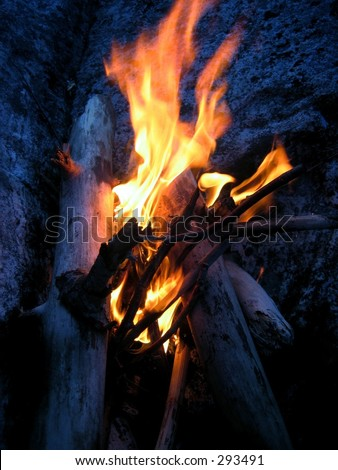 Close-up of an evening campfire. - stock photo