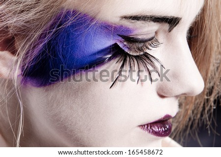 close-up of an eye with fake eyelashes and original make-up - stock photo