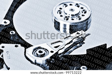 Close-up of an hard disk drive and a binary code overlay - stock photo