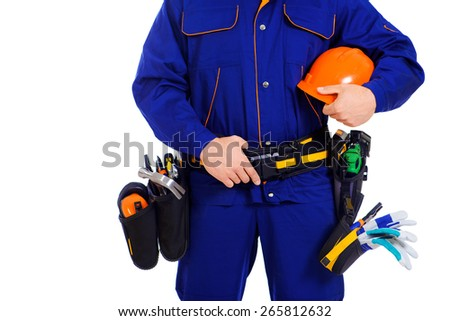 Close-up of an industrial worker wearing uniform and tools. Job, occupation. Isolated over white.  - stock photo