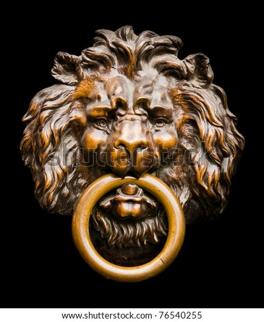 Close up of an isolated lion-shaped door knocker - stock photo