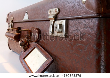 close-up of an old brown vintage suitcase - stock photo