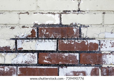 Close Up of an Old Exterior Red Brick Wall with Peeling Paint
