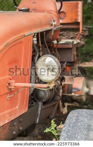 Close up of an old lamp from a tractor - stock photo