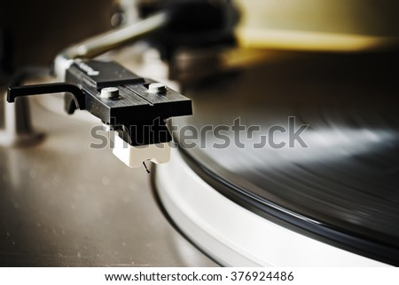 close up of an old record player stylus - stock photo
