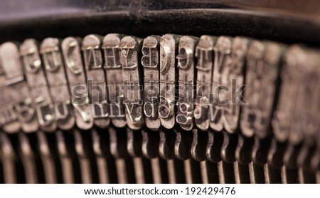 Close-up of an old retro typewriter with paper, natural colors - stock photo