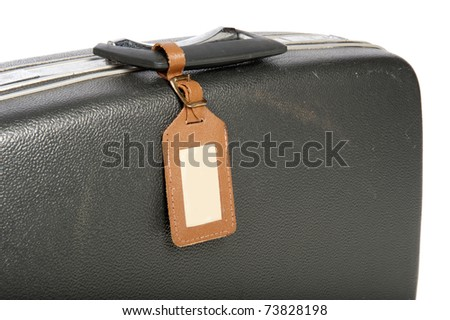 Close-up of an old suitcase isolated on white - stock photo