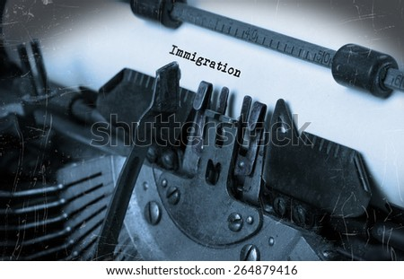 Close-up of an old typewriter with paper, selective focus, Immigration - stock photo
