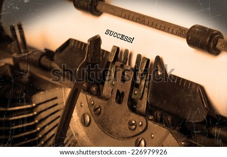 Close-up of an old typewriter with paper, selective focus, success - stock photo