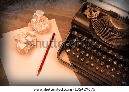 Close-up of an old typewriter with paper, vintage look, warm - stock photo