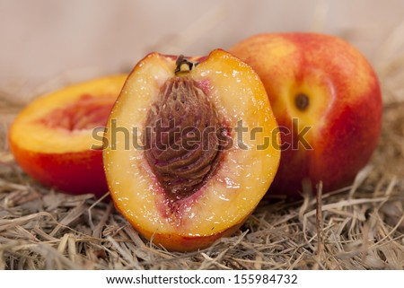 Close up  of an Ontario grown fresh peach. Cut open to see the juice - stock photo