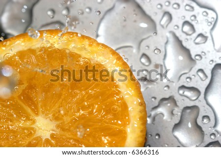 close up of an orange on metal background - stock photo