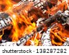 Close up of an outdoor fire burning - stock photo