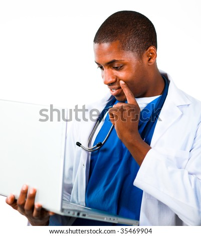 Close-up of an Thoughtful Afro-American doctor working with a computer - stock photo