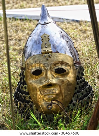 close up of ancient golden helmet background - stock photo