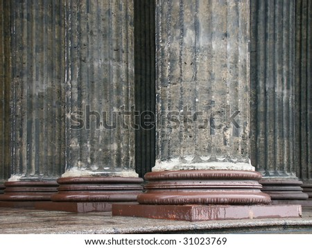 Close-up of ancient stone columns. - stock photo
