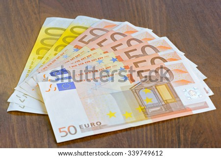 Close-up of 50 and 200 Euro banknotes on the table - stock photo