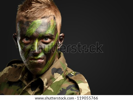 Close Up Of Angry Soldier against a black background - stock photo