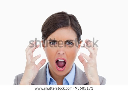 Close up of angry yelling entrepreneur against a white background - stock photo