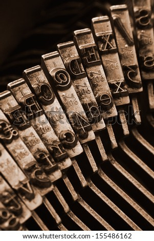 Close up of antique typewriter typebars with focus on the at symbol, great concept for blogs, journalism, news or the mass media - stock photo