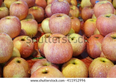 close up of apples on market stand - stock photo