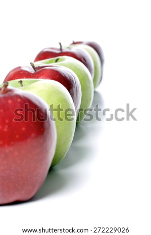 Close up of apples on white background - stock photo