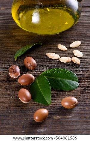 Close up of Argan fruits and oil with leaves