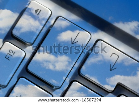 Close-up of arrow keys overlaid with cloudy sky image - stock photo